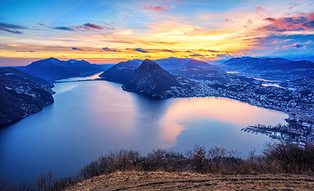 Dramatic sunset over Lake Lugano in swiss Alps, Switzerland